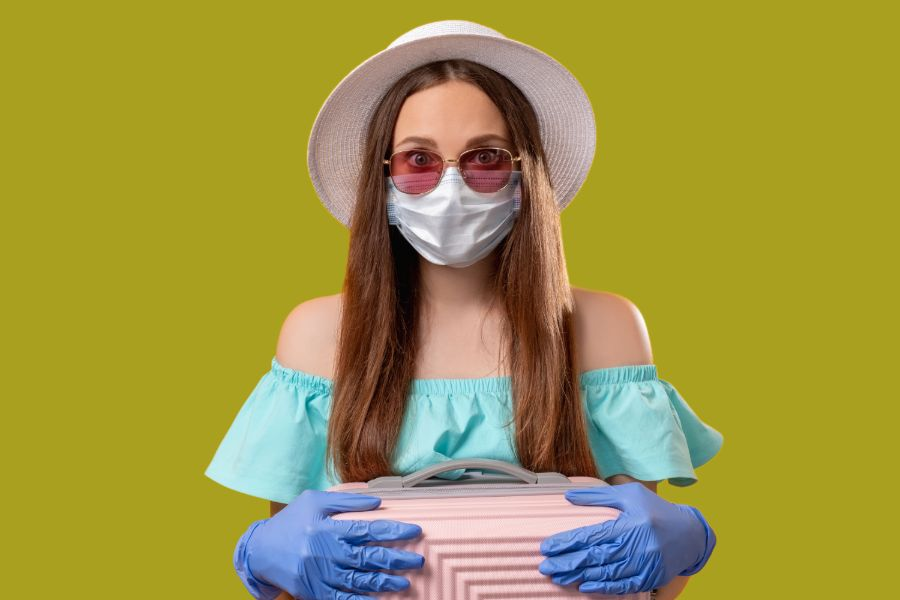 A Travel-ready Woman Wearing Disposable Gloves and a Face Mask